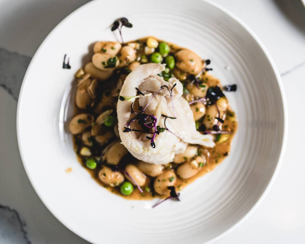 Poached Petrale Sole served over Italian butter beans